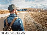 A bearded man in a cap with a backpack ready to go a long way. A man... Стоковое фото, фотограф Zoonar.com/Ian Iankovskii / easy Fotostock / Фотобанк Лори