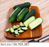 Cucumbers and knife on wooden cutting board. Стоковое фото, фотограф Яков Филимонов / Фотобанк Лори