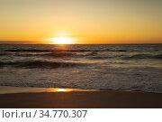Waves and sunset at the beach. Стоковое фото, агентство Wavebreak Media / Фотобанк Лори