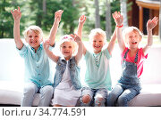 Group of happy smiling children outdoors. Стоковое фото, фотограф Zoonar.com/Tatiana Badaeva / easy Fotostock / Фотобанк Лори