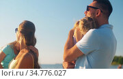 happy family with daughters on summer beach. Стоковое видео, видеограф Syda Productions / Фотобанк Лори