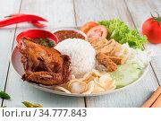 Nasi lemak kukus with fried chicken, popular traditional Malaysian... Стоковое фото, фотограф Zoonar.com/szefei / easy Fotostock / Фотобанк Лори