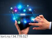Businessman holding a foldable smartphone with SHARE inscription,... Стоковое фото, фотограф Zoonar.com/rancz / easy Fotostock / Фотобанк Лори