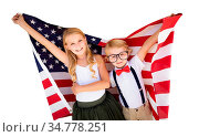 Cute Young Cuacasian Boy and Girl Holding American Flag Isolated On... Стоковое фото, фотограф Zoonar.com/Andy Dean Photography / easy Fotostock / Фотобанк Лори