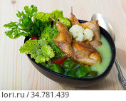 Cream soup with quails, broccoli, brussels sprouts and cauliflower. Стоковое фото, фотограф Яков Филимонов / Фотобанк Лори