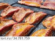 pork ribs preparing on grill brazier. Стоковое фото, фотограф Яков Филимонов / Фотобанк Лори