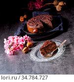 Juicy poppy seed cake with apples and chocolate glaze. Стоковое фото, фотограф Zoonar.com/Darius Dzinnik / easy Fotostock / Фотобанк Лори