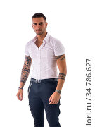 Handsome young man in white shirt and jeans posing isolated on white... Стоковое фото, фотограф Zoonar.com/STEFANO CAVORETTO / easy Fotostock / Фотобанк Лори