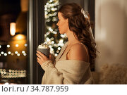 woman holding mug with whipped cream on christmas. Стоковое фото, фотограф Syda Productions / Фотобанк Лори