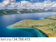 Aerial shot, Lake Khovsgol, Mongolia, August 2005. Стоковое фото, фотограф Jeff Foott / Nature Picture Library / Фотобанк Лори