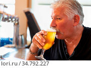 Handsome Man Tasting A Glass Of Micro Brew Beer. Стоковое фото, фотограф Zoonar.com/Andy Dean Photography / easy Fotostock / Фотобанк Лори