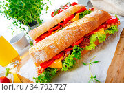 Crispy baguette with bacon, tomatoes and cheese. Стоковое фото, фотограф Zoonar.com/Darius Dzinnik / easy Fotostock / Фотобанк Лори