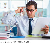 Businessman suffering from excessive armpit sweating. Стоковое фото, фотограф Elnur / Фотобанк Лори
