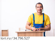 Young male carpenter working indoors. Стоковое фото, фотограф Elnur / Фотобанк Лори