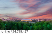view of central Moscow from Sparrow Hills or Vorobyovy Gory observation (viewing) platform at sunset-- is on a steep bank 85 m above the Moskva river, or 200 m above sea level. Russia. Стоковое фото, фотограф Владимир Журавлев / Фотобанк Лори