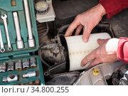 Male hands inserting air filter in plastic box of car engine. Стоковое фото, фотограф Кекяляйнен Андрей / Фотобанк Лори