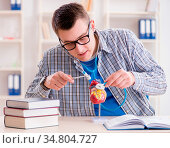The medical student studying heart in classroom during lecture. Стоковое фото, фотограф Zoonar.com/Elnur Amikishiyev / easy Fotostock / Фотобанк Лори