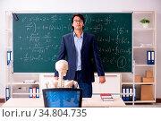 Young male math teacher and student skeleton. Стоковое фото, фотограф Zoonar.com/Elnur Amikishiyev / easy Fotostock / Фотобанк Лори