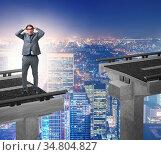 The young businessman in uncertainty concept with bridge. Стоковое фото, фотограф Zoonar.com/Elnur Amikishiyev / easy Fotostock / Фотобанк Лори
