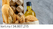 Panoramic web banner crop for Grocery bag with egg cooking oil and... Стоковое фото, фотограф Zoonar.com/Vichie81 / easy Fotostock / Фотобанк Лори