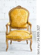Vintage luxury Yellow sofa Armchair in vintage room. Стоковое фото, фотограф Vichaya Kiatying-Angsulee / easy Fotostock / Фотобанк Лори