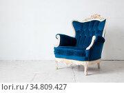 Blue classical style Armchair sofa couch in vintage room. Стоковое фото, фотограф Vichaya Kiatying-Angsulee / easy Fotostock / Фотобанк Лори