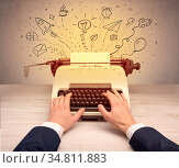 Typewriter with doodles, idea, message, plane, car balloon social... Стоковое фото, фотограф Zoonar.com/rancz / easy Fotostock / Фотобанк Лори
