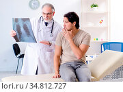 Young man visiting old male doctor radiologist. Стоковое фото, фотограф Zoonar.com/Elnur Amikishiyev / easy Fotostock / Фотобанк Лори