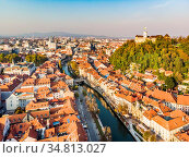 Aerial panoramic view of Ljubljana, capital of Slovenia in warm afternoon... Стоковое фото, фотограф Zoonar.com/Matej Kastelic / easy Fotostock / Фотобанк Лори