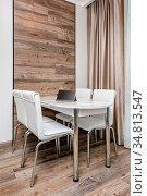 Modern cozy dining room, minimalistic clean design. Стоковое фото, фотограф Zoonar.com/Serghei Starus / easy Fotostock / Фотобанк Лори