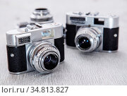 Photography, vintage. Retro camera on the table. Стоковое фото, фотограф Zoonar.com/Yeko Photo Studio / easy Fotostock / Фотобанк Лори