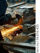 Cutting steel with an electric circular saw. Стоковое фото, фотограф Андрей Радченко / Фотобанк Лори