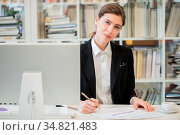 Portrait of business woman working with financial documents and computer... Стоковое фото, фотограф Zoonar.com/Ivan Mikhaylov / easy Fotostock / Фотобанк Лори
