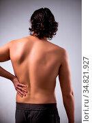 The man suffering from backbain on gray. Стоковое фото, фотограф Zoonar.com/Elnur Amikishiyev / easy Fotostock / Фотобанк Лори