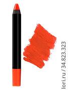 Orange cosmetic pencil lipstick with matching color stroke sample... Стоковое фото, фотограф Zoonar.com/Arthur Mustafa / easy Fotostock / Фотобанк Лори
