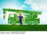 Businessman with green ecological vehicle. Стоковое фото, фотограф Zoonar.com/Elnur Amikishiyev / easy Fotostock / Фотобанк Лори