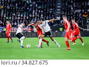 Wolfsburg, Germany, March 20, 2019: footballers Jonathan Tah (GER... Редакционное фото, фотограф Michele Morrone / age Fotostock / Фотобанк Лори