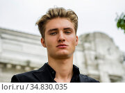 Handsome blond young man head-shot outdoors, looking at camera. Стоковое фото, фотограф Zoonar.com/Stefano Cavoretto / easy Fotostock / Фотобанк Лори