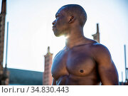 Portrait of a hot black man shirtless in urban environment, walking... Стоковое фото, фотограф Zoonar.com/STEFANO CAVORETTO / easy Fotostock / Фотобанк Лори