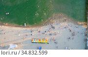 Aerial view of sandy beach with tourists swimming in beautiful clear sea water. Стоковое фото, фотограф Арестов Андрей Павлович / Фотобанк Лори