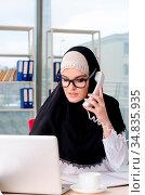 Woman muslim employee working in the office. Стоковое фото, фотограф Zoonar.com/Elnur Amikishiyev / easy Fotostock / Фотобанк Лори