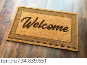Welcome Mat On A Wood Floor Background. Стоковое фото, фотограф Zoonar.com/Andy Dean Photography / easy Fotostock / Фотобанк Лори