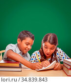 Blank Chalk Board Behind Hispanic Boy and Girl Having Fun Studying... Стоковое фото, фотограф Zoonar.com/Andy Dean Photography / easy Fotostock / Фотобанк Лори