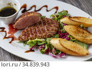 Grilled duck breast with honey sauce and salad. Стоковое фото, фотограф Richard Semik / easy Fotostock / Фотобанк Лори