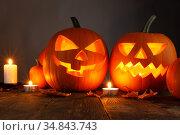 Halloween pumpkins and candles. Стоковое фото, фотограф Иван Михайлов / Фотобанк Лори