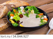 Cream soup with shitake mushroom served with vegetables and greens. Стоковое фото, фотограф Яков Филимонов / Фотобанк Лори