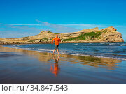 Running man in ocean coast, New Zealand. Стоковое фото, фотограф Zoonar.com/Galyna Andrushko / easy Fotostock / Фотобанк Лори