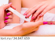 Woman hands during manicure procedure. Стоковое фото, фотограф Zoonar.com/Elnur Amikishiyev / easy Fotostock / Фотобанк Лори