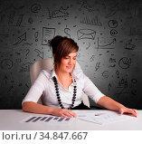 Young secretary with doodle multitask concept. Стоковое фото, фотограф Zoonar.com/ranczandras / easy Fotostock / Фотобанк Лори