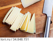 Sliced italian cured sheep cheese Pecorino. Стоковое фото, фотограф Яков Филимонов / Фотобанк Лори